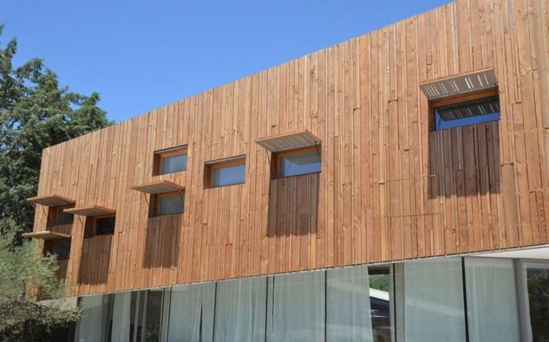 bardage et volets bois - Maison Spirale par Portal Thomas Teissier Architecture - Catelnau Le Lez, France