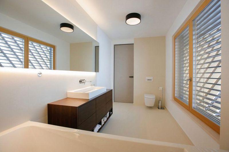 maison contemporaine en t combinant bois et b ton en. Black Bedroom Furniture Sets. Home Design Ideas