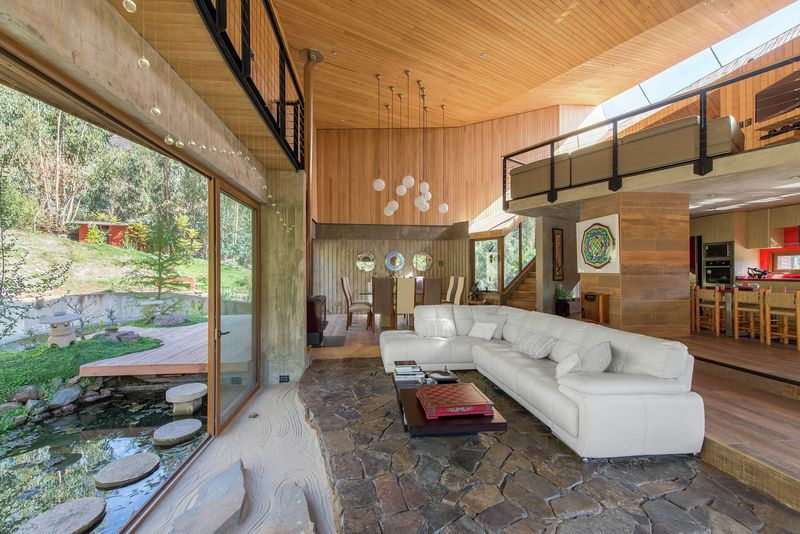 pi ce de vie grande baie vitr e coulissante el maqui house par gitc arquitectura. Black Bedroom Furniture Sets. Home Design Ideas