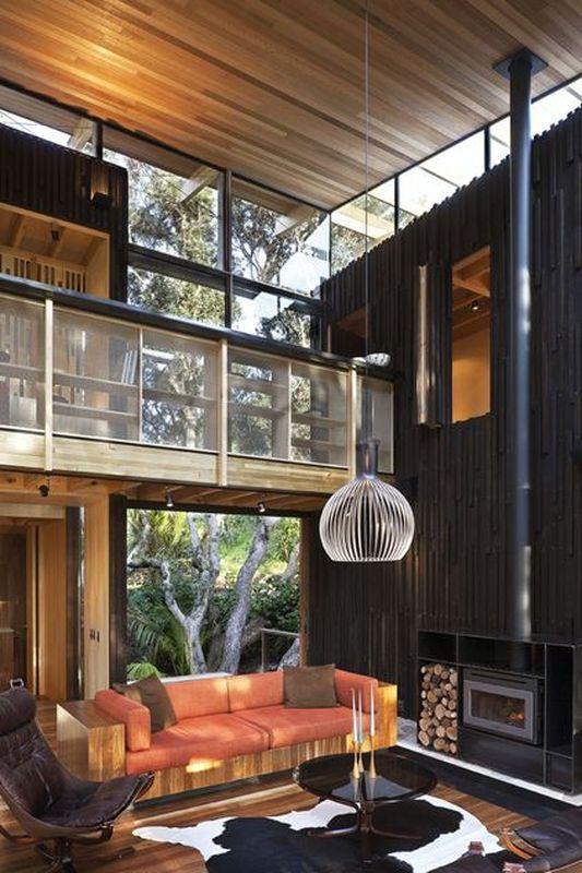 Maison bois contemporaine camoufl e par des pohutukawas en for Www nouvelle maison design com