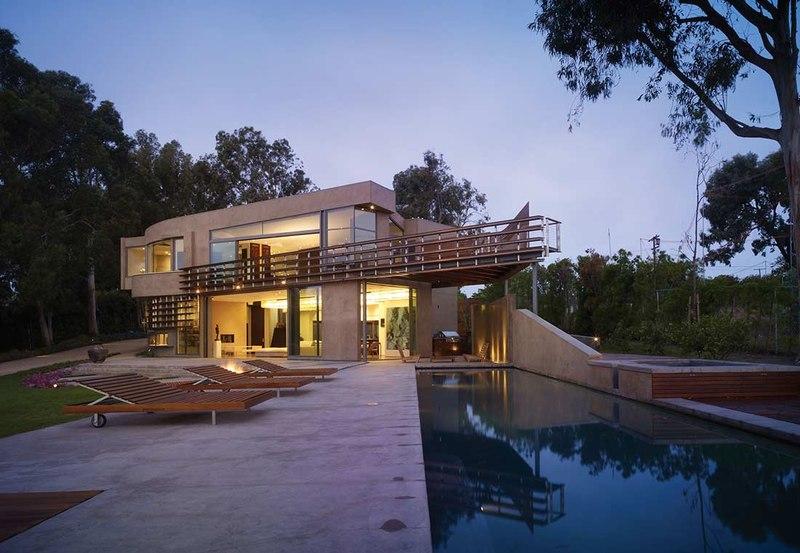 Maison contemporaine avec une forme carrel e aux usa construire tendance - Salon construction maison ...