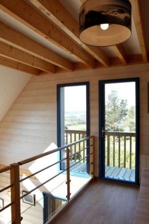 accès balcon - Maison bois bioclimatique par Patrice Bideau architecte