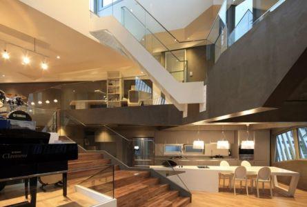 îlot de cuisine & escalier accès étage - Kyeong Dok Jai par Uroje Khm Architects - Corée du Sud