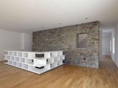 étagère séjour - House-transformation par clavienrossier architects - Suisse