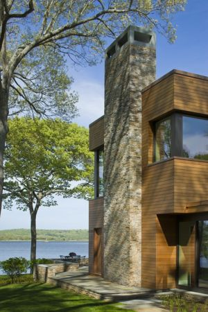 conduit cheminée en pierre - Secluded contemporary home par Point One Architects - Essex, Usa