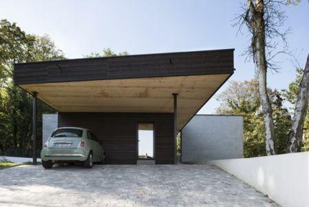 entrée et porte à faux garage - War house par A+B architectes - Montmorency, France