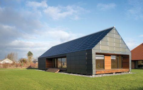 façade terrasse - La Casa de Libre Mantenimiento par Arkitema Architects  - Danemark