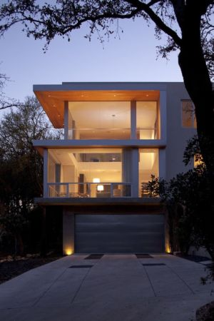 garage et étages de nuit - City View Residence par Dick Clark Architecture - Austin, Usa