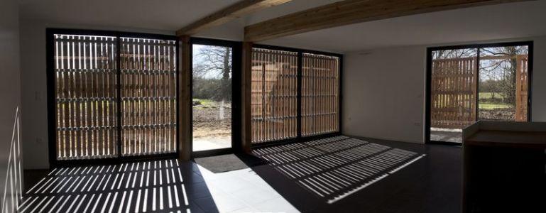 pièce de vie - Maison ossature bois par Atelier 56S - France - Photo Jeremías Gonzalez
