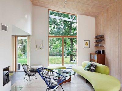 salon et cheminée - Green Bean House par Arctic Studio - Onsala, Suède