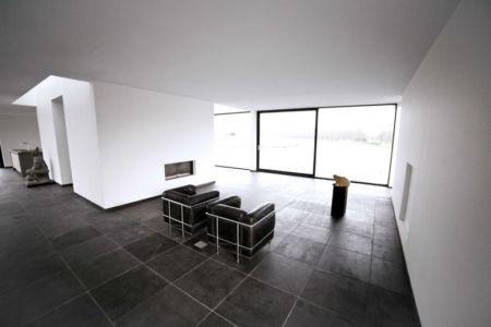 salon et cheminée - Private Villa par Engel Architecten - Blauwestad, Pays-Bas
