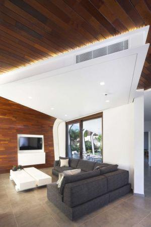 salon & vue extérieur baie vitrée - tsikkinis par Tsikkinis Architecture Studio - Limassol, Chypre