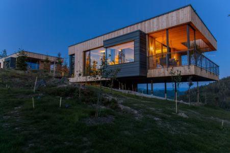 vue côté de nuit - Deluxe Mountain Chalets par Viereck Architects - Styria, Autriche