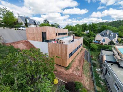 vue principale - maison bois par Hugues Tournier - Cardaillac, France