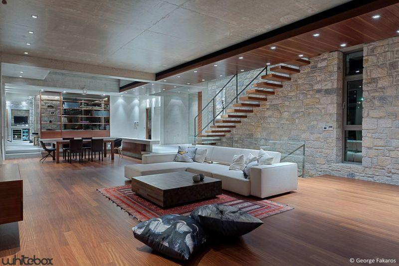 bibliothèque séjour-salon - Stone House par Whitebox Architects - Athènes, Grèce