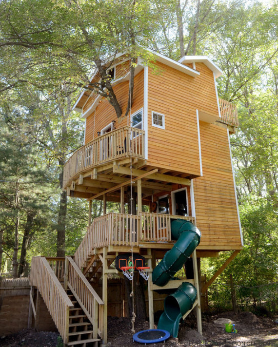 RICK FOSTER STORY; VIDEO Jay Hewitt of Attleboro is putting the finishing touches on an elaborate tree house he built for his grandchildren in a tree in his backyard.