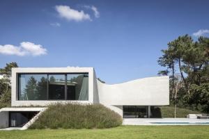 Maison semi enterree construire tendance for Assurance maison belgique